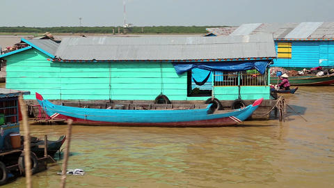 Floating village of Vietnamese refugees on Tonle Sap lake in Siem Reap, Cambodia Live Action