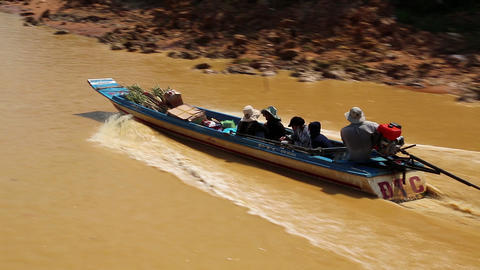 Boat with people floats on the river to the Tonle Sap lake in Siem Reap province Footage