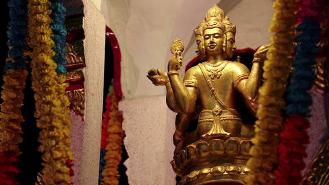 Golden Statue Of Deity On The Street In Pattaya, Thailand stock footage