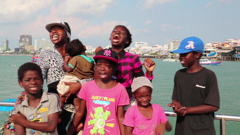 Afro-American Family Sings A Song On The Shore Of The Gulf Of Siam In Pattaya stock footage