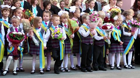 Beginning of school year. Children stand near the school in Kiev, Ukraine Live Action