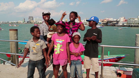 Afro-American family sings a song on the shore of the Gulf of Siam in Pattaya Footage