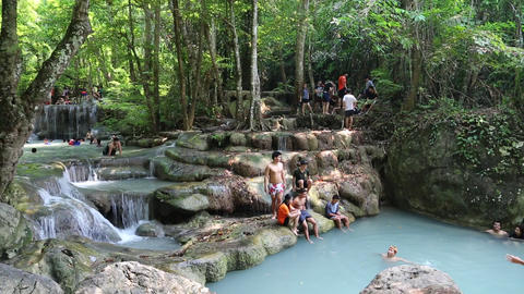 People in Erawan National Park and Erawan Waterfall in western Thailand Footage