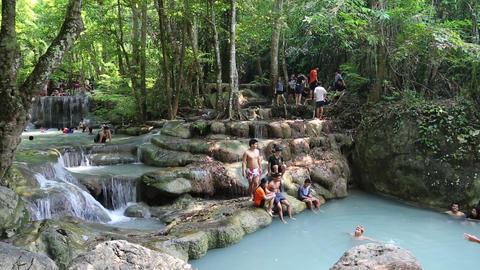 People in Erawan National Park and Erawan Waterfall in western Thailand Footage
