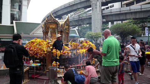 Thai people near mini buddhist temple in Bangkok downtown, Thailand Footage