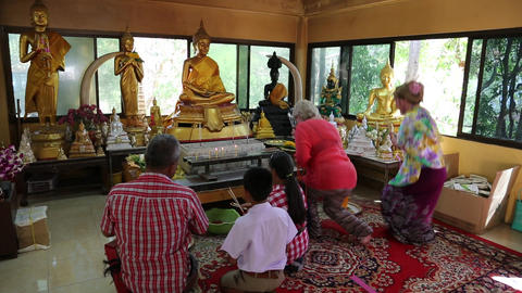 People in Buddhist temple on Pratumnak Hill near Golden Buddha statue in Pattaya Footage