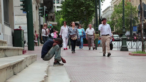 Beggar and people on the street in Athens, Greece Footage