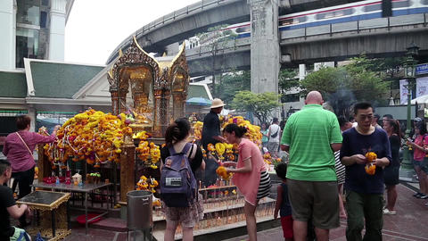 Thai people near mini buddhist temple in Bangkok, Thailand Footage