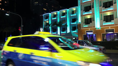 Road traffic near hotel with night illumination in Pattaya, Thailand Footage