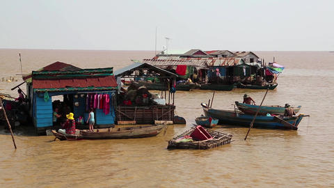 Floating village of Vietnamese refugees on Tonle Sap lake in Siem Reap, Cambodia Footage