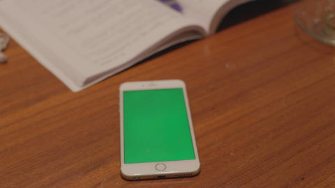 Iphone 6 Plus White - Greenscreen Pan On Desk stock footage