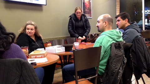Close up people enjoying meal in coffee shop Footage