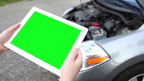 A Woman Holds A Blank Tablet PC With A Green Scree stock footage