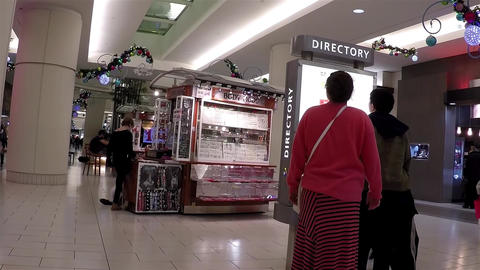 People Checking Direction Map Inside Shopping Mall stock footage