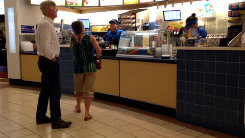 Couple Buying Juice At Food Court Inside Coquitlam stock footage