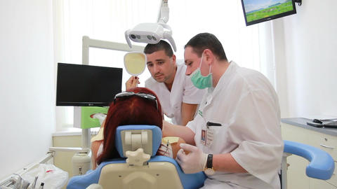Stomatology - dentists show result of work to the patient Footage