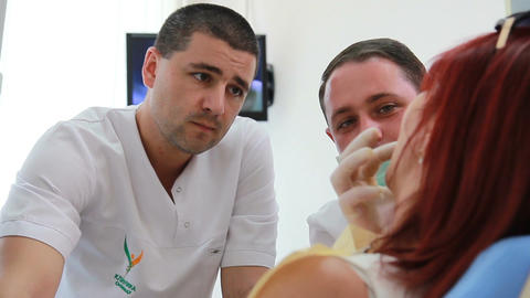Therapeutic Dentistry - Dentists Discuss The Progr stock footage