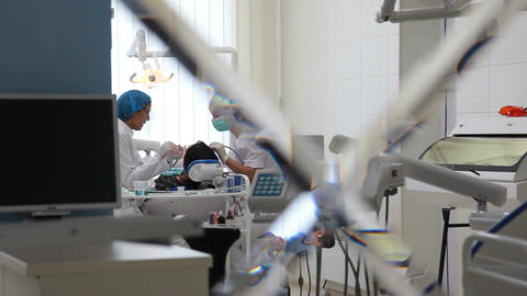 Dental surgery during operation of doctors (shot from the consulting room) Live Action