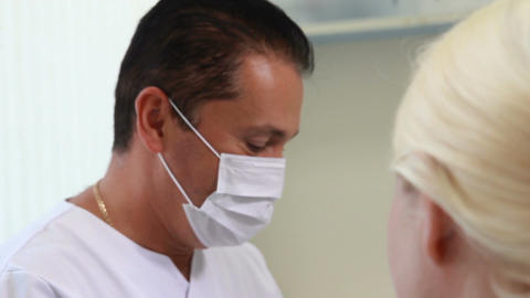 Stomatology - the dentist explains the course of the operation to the patient Live Action