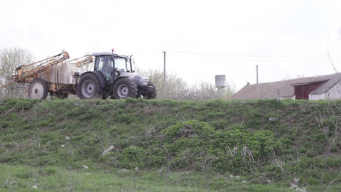 Tractor With Sprayer Travels On The Road stock footage
