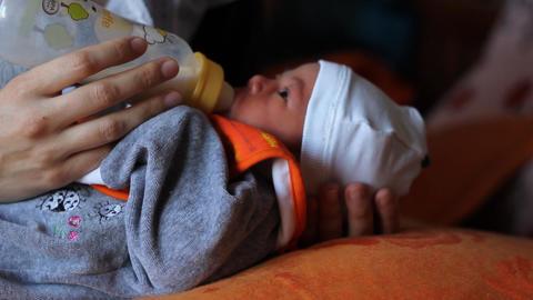 Newborn Sucking Milk of Bottle Footage
