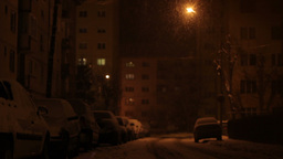 Nighttime Snowing on Cars and Street Footage