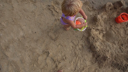 child with ball in the bucket goes to the sea Footage