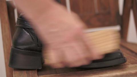 Woman Brushing High Boot Inside Leg Live Action