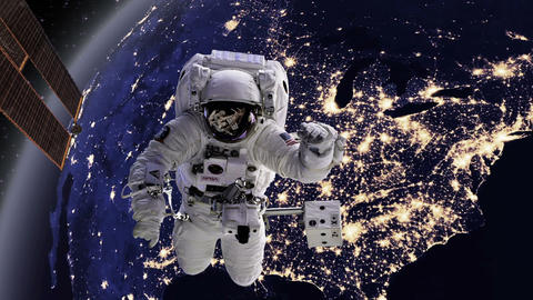 Astronaut in space with Earth, USA, America behind Footage