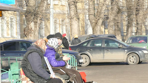 Beggars of the road among cars begging Stock Video Footage