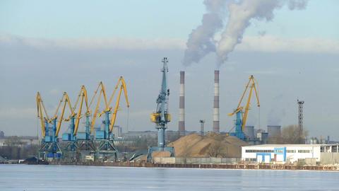 Industrial landscape - cranes, pipe smoke, winter, Footage
