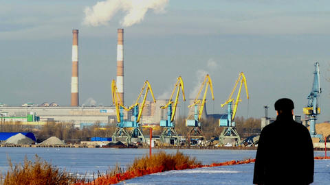 Industrial landscape - cranes, pipe smoke, winter, Stock Video Footage