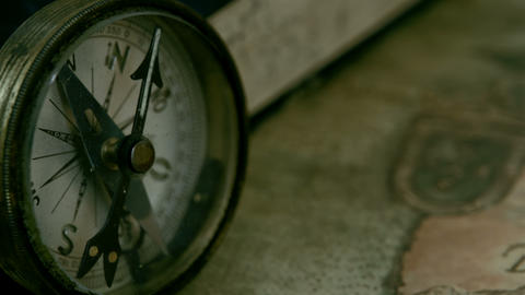 Left angle view of the compass and the book Stock Video Footage