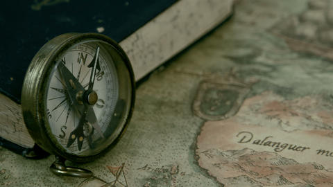 Left angle view of the compass and the book Footage