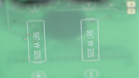 The green micro chip of the battery Footage