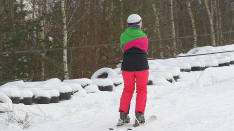A lady in pink riding the ski lift Footage