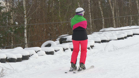 A lady in pink riding the ski lift Stock Video Footage