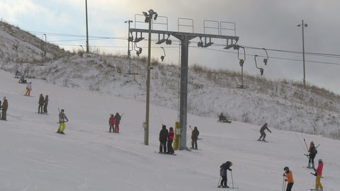 Some people are riding the ski lift on the resort Footage
