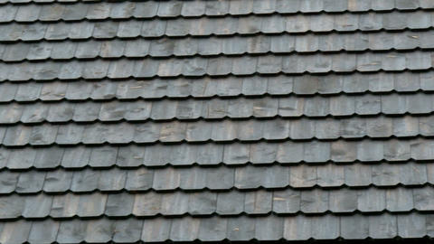 Tiles of the newly constructed shingle roof Stock Video Footage