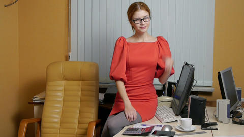 Young woman secretary at work at the office Stock Video Footage