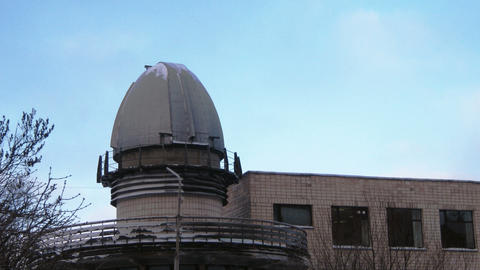 Time lapse clouds running behing observatory dome Stock Video Footage