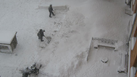 Men removing snow from the road Stock Video Footage