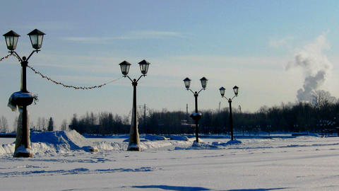 Winter landscape with lanterns and smoking factory Footage