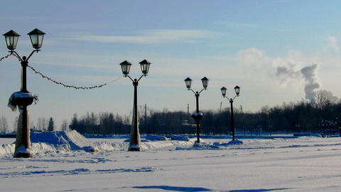 Winter landscape with lanterns and smoking factory Stock Video Footage