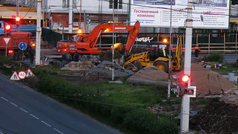 Excavator works on the road time lapse Stock Video Footage