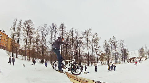 Bikers snow jumping Footage
