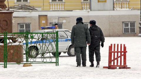 Policemen walking on Dvortsovaya square, St. Peter Stock Video Footage