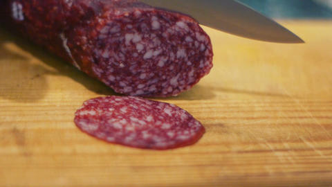 Cutting salami to slices Stock Video Footage