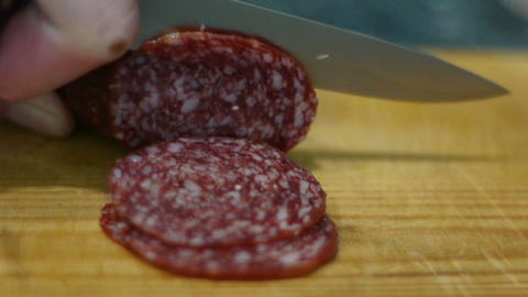 Cutting sausage to slices Footage
