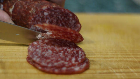 Cutting sausage to slices Stock Video Footage